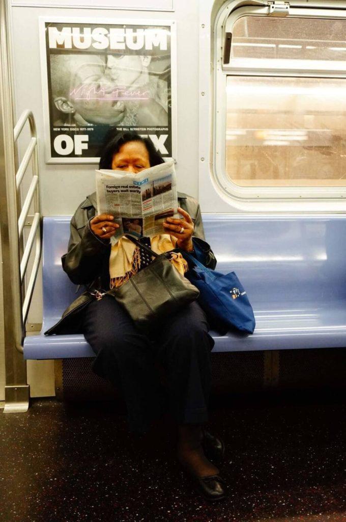 New York Subway Person Reading
